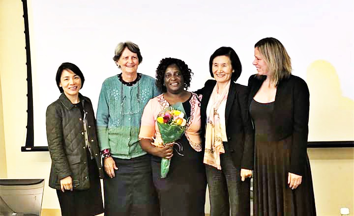(Jasintha surrounded by University of Massachusetts Boston faculty after successfully defending her doctoral dissertation. Left to right: Ling Shi, Ph.D.; MarySue Makin, MD; Jasintha Mtengezo, Ph.D.; Haeok Lee, Ph.D.; Mary Cooley, Ph.D.)