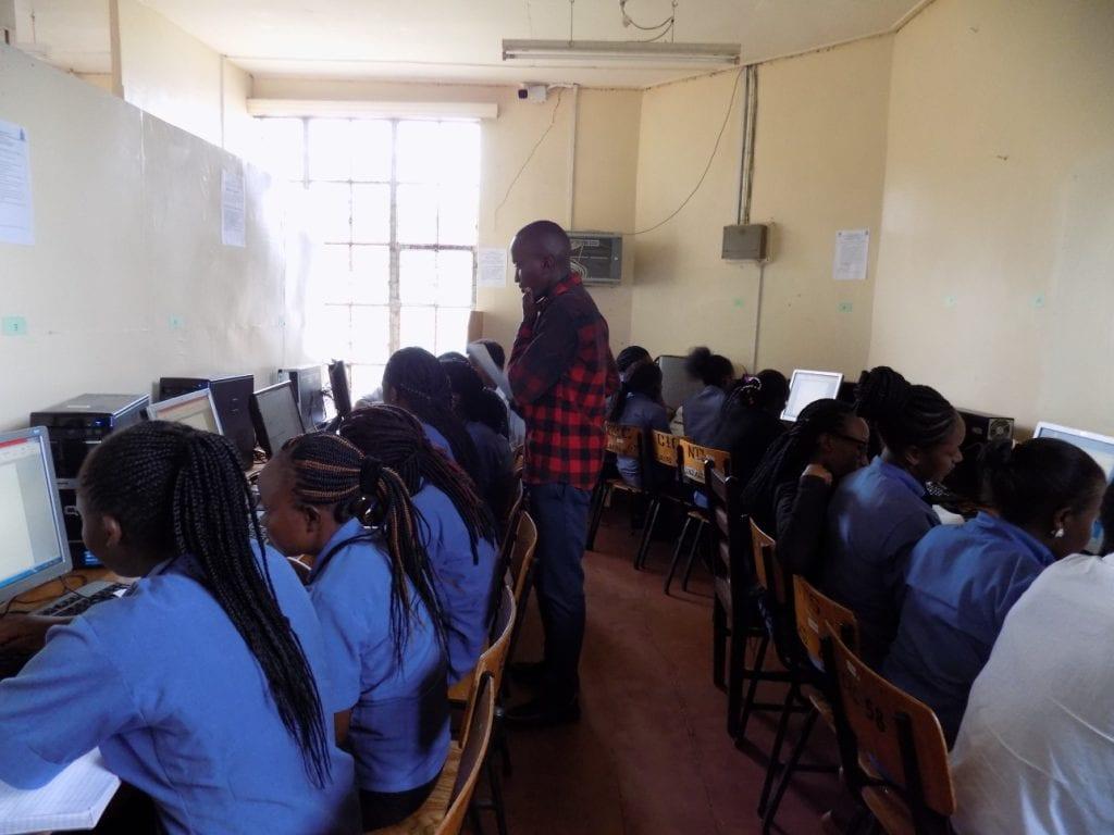 Nursing students at Chogoria Hospital use eGranary as Nursing educator Dennis Ngari facilitates their learning.